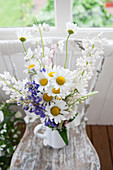A summery bouquet with lupines and daisies