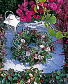 Grave wreath stuck on moist floral foam, Abies (fir),