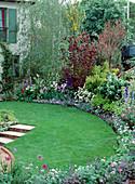 Lawn with Flowerbed, Lupinus, Iris, Delphinium, Allium
