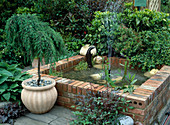 Bricked pond with fountain and copper beaver