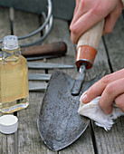 Clean and disinfect the hand scoop with gun oil