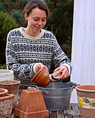 Clean clay pots with vinegar water
