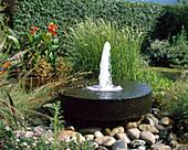 Millstone as a fountain