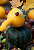 Ornamental gourd and oak leaf bird