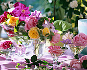 Glass bowls with rose and clematis flowers