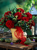 Rose bouquet with red roses, hypericum with berries, book