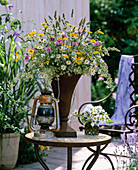 Meadow bouquet in an iron vase