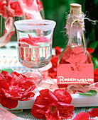 Making rose water, sugared rose petals, glass