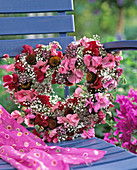 Wire wreath with flowers of Lathyrus (sweet pea), Gypsophila