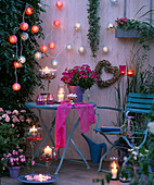 Fairy lights made of tissue paper balls with roses decoration