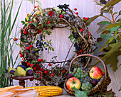 Tie wreath of berry jewelery and clematis fruit stands