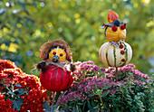 Pumpkin woman and pumpkin man made of ornamental gourds, chrysanthemum, sedum stonecrop