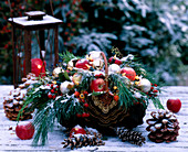 Christmas basket with branches, nuts, pine cones and apples