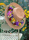 Straw hat with flower wreath