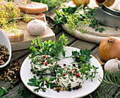 Goat's cheese rolled in herbs, colorful pepper