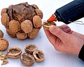 Stick walnut ball Juglans walnut halves to the ball with hot glue