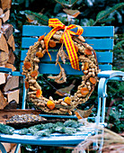 Self made birdseed wreath of millet, apricots and Nobilistanne