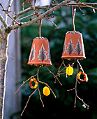 Homemade birdseed made of clay pot and branches