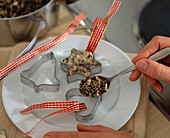 Fird fat ball to hang, fill the grain mixture in baking tin