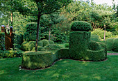 Topiary with Buxus sempervirens cut into ornate sculptures
