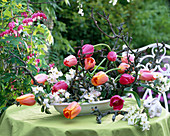 Arrangement of tulips and apple blossoms