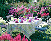 Table in front of flowerbed with hydrangea