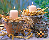Candles in rustic pots with triticum (wheat)