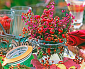 Bouquet made of pink (rosehip), Erica (pottery) in preserving jar