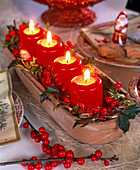 Unusual Advent wreath with red candles and ilex