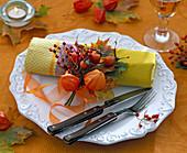 Autumn napkin decoration with little Physalis bouquet