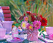 Bouquet made of dahlia in pink and claret with pennisetum