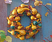 Cucurbita (ornamental squash) and pink (rosehip) wreath
