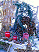 Pine cones and acorns wreath with hoarfrost