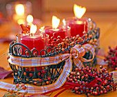 Multiflora rose, mini rosehips, candied jardiniere with candles, ribbon