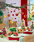 Table decoration with malus (apple), apples under glass bells