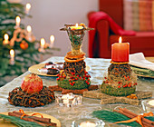 Table decoration with star anise balls, wreaths and candles