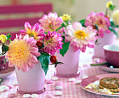 Dahlia (pink dahlia), pink (rosehip) in small pink glass vases