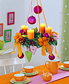Chamaecyparis, hanging Advent wreath with orange candles