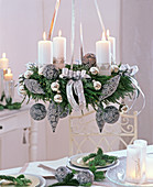 Ceiling wreath with white candles and gray-silver tree ornaments on Cryptomeria