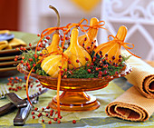 Cucurbita, Rose, moss, yellow ribbons, glass bowl