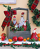 Santa Claus made of chocolate and porcelain in wooden box