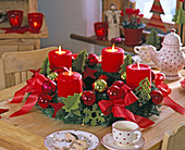 Advent abies (fir) wreath with red candles and bows