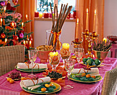 Table decoration with spices like cinnamon sticks, star anise