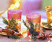 Glasses with tealights, decorated with Cupressus arizonica