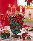Unusual Christmas wreath with red candles on rust colored