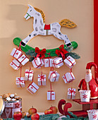 Advent calendar of white parcels on rocking horse