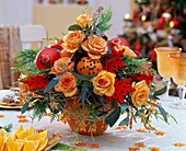 Roses bouquet with spiked oranges and Christmas baubles