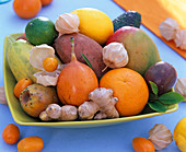 Bowl of exotic fruits, citrus (orange, lemon)