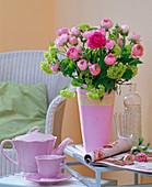 Bouquet made of ranunculus and viburnum (snowball)