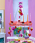 Hanging table decoration, candle wreath decorated with candles and ribbon